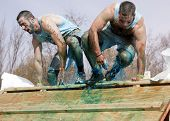 POCONO MANOR, PA - APR 28: Two men emerge from a tank filled with water and ice at Tough Mudder on A