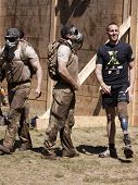 POCONO MANOR, PA - APR 29: Team members stand between the Berlin Walls obstacle at Tough Mudder on A