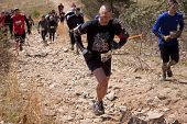 POCONO MANOR, PA - APR 28: Entrants face rocks on a steep incline for the Death March obstacle at To