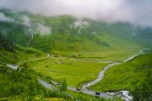 Beautiful Landscape And Scenery View Of Norway, Green Scenery Hills And Mountain In A Cloudy Day. Gr poster