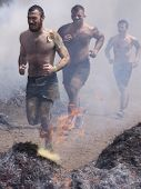 POCONO MANOR, PA - APR 28: A group of men runs through the Fire Walker obstacle at Tough Mudder on A