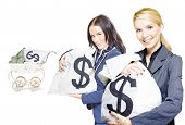 Pretty Young Business Women Holding Sacks Of Money