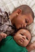 Two Multiethnic Boys Brothers (focus On Baby)