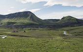 View On Hvanngil Mountain Hut And Camp Site With Green Hills, River Stream And Lush Grass And Moss.  poster