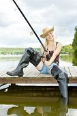 stock photo of fisherwomen  - fishing woman sitting on pier - JPG
