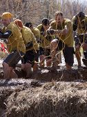 POCONO MANOR, PA - APR 29: A team runs through an obstacle with electrified wires at Tough Mudder on