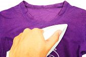 hand was ironing purple cloth