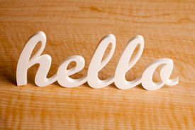 stock photo of cursive  - Cursive Acrylic Hello Sign on Wooden Table - JPG