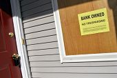 Real Estate Bank Owned Sign On Foreclosure House