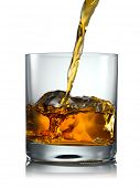 image of scotch  - Pouring Glass of scotch whiskey and ice on a white background - JPG