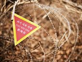 stock photo of landmines  - A sign indicating the end of a landmine zone in South Korea - JPG