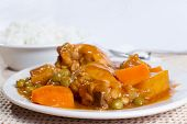 Chicken Afritada With Bowl Of Rice Closeup