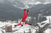 BUKOVEL, UKRAINE - FEBRUARY 23: Thomas Lambert, Switzerland performs aerial skiing during Freestyle