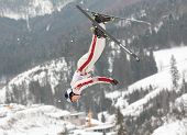 BBUKOVEL, UKRAINE - FEBRUARY 23: Travis Gerrits, Canada performs aerial skiing during Freestyle Ski
