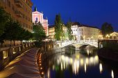 stock photo of yugoslavia  - Ljubljana at night with the Triple Bridge Slovenia - JPG