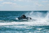 High speed jet ski with water spray