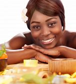 Image of beautiful afro female with franjipani flower in head enjoying dayspa, american woman relaxe