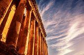 Photo of Baalbek Heliopolis ruins, ancient Lebanon landmark over dark blue sky, arabian architecture, antique religions building, famous jupiter monument, columns statue, retro style image