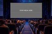 stock photo of watching movie  - Empty cinema screen with audience - JPG