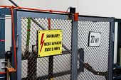 High Voltage Warning Signs On A Fence Before The Equipement