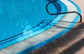 metal railings stairs pool with reflection