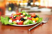 Tasty Greek salad on table in cafe