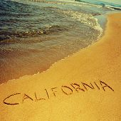 california written on the sand of a beach, with a retro effect