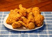 Fresh Fried Chicken On Blue Plaid Placemat