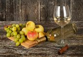 Bottle Of White Wine, Glass And Fruits