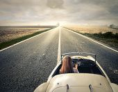 stock photo of horizon  - beautiful woman traveling on a vintage car - JPG