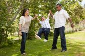 Young Family Having Fun In The Park