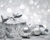 Christmas gift on silver lights background
