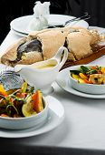 Baked Whole Fish In A Salt Crust Served With Vegetable Salad And Sauce