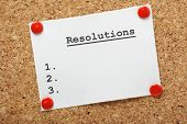 image of promises  - A blank list of resolutions for new year or in general pinned to a cork notice board with room for your text - JPG