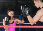 Determined female boxer focused on her training in the boxing ring