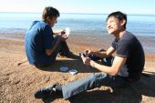 Two Men Play Cards On The Shores