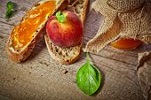 Sweet peach jam on bread