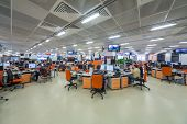 MOSCOW - MAR 5: Employees work in office buildings news agency RIA Novosti with orange furniture and