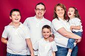 Five Member Family Smiling