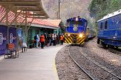 Train to Machu Picchu pueblo arrives to Ollantaytambo station.