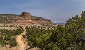 stock photo of chimney rock  - Chimney Rock at the San Rafael Swell in Emery County Utah at then end of a dirt road and showing Cedar Mountain in the background - JPG