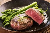 image of cook eating  - steak with green asparagus - JPG
