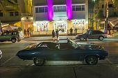People Enjoy Nightlife At The Colorful Ocean Drive By Night