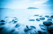 Rocks In Surf Of Fantastic Seascape