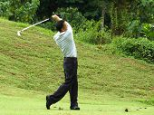 Golfer In Full Swing