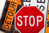 Detour sign, stop sign and road closed sign as a background