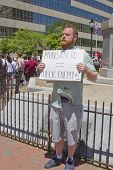 Man Holds Anti Monsanto Sign At A Gmo Rally In Asheville
