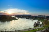 KRAKOW, POLAND - OCT 19: View of the embankment of Vistula River in the historic city center, Oct 19, 2013 in Krakow, Poland. Vistula is the longest river in Poland, at 1,047 kilometres in length.