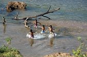 Children Bathe In The River