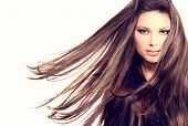 Fashion Model Girl Portrait with Long Blowing Hair. Sexy Glamour Beautiful Woman with Healthy and Be